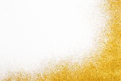 Golden glitter sand texture frame on white, abstract background.