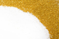 Golden glitter sand texture frame on white, abstract background. Royalty Free Stock Image