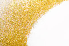 Golden glitter sand texture frame on white, abstract background. Royalty Free Stock Photography