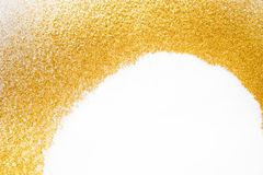 Golden glitter sand texture frame on white, abstract background. Stock Images