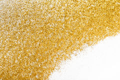 Golden glitter sand texture frame on white, abstract background. Royalty Free Stock Images