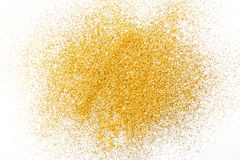 Golden glitter sand texture on white, abstract background. Stock Photography