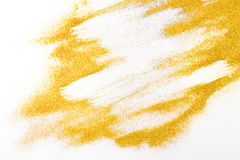 Golden glitter sand texture on white, abstract background. Yellow dusty shimmer decoration, shiny and sparkling. Holidays and glamour concept royalty free stock image