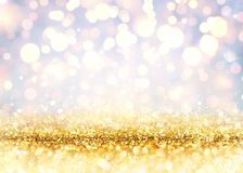 Golden Glitter On Shiny backdrop stock photography