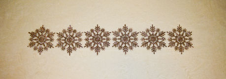 Golden Glitter Snowflakes Ornaments in a Row Stock Photography