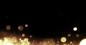 Golden glitter sparkle bubbles particles on black background flowing from bottom, event festive happy new year holiday stock footage