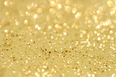Golden glitter sparkles dust  background. Super macro, shallow DOF