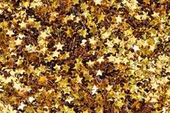 Golden glitter stars textured background stock images