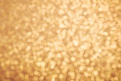 Golden glitter texture. Christmas expensive abstract background. Blured bokeh. Stock Photo