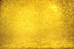 Golden glitter texture Colorfull Blurred abstract background for birthday, anniversary, wedding, new year eve or Christmas Royalty Free Stock Image