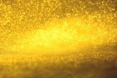 Golden glitter texture Colorfull Blurred abstract background for birthday, anniversary, wedding, new year eve or Christmas Stock Photo