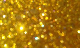 Golden glitter textured background,Bright beautiful shining golden glitter. royalty free stock photo