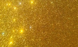 Golden glitter textured background,Bright beautiful shining golden glitter. stock images
