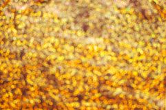 Golden glittering background stock photography