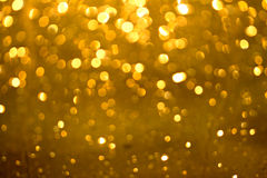 Golden glittering bokeh background Royalty Free Stock Photo