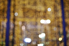 Golden glittering christmas lights. Blurred abstract background Royalty Free Stock Photos