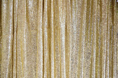 The golden glittering curtain. For background royalty free stock photography
