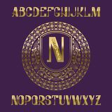 Golden glittering letters with monogram template. Awesome font and elements kit for logo design.  royalty free illustration