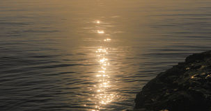 Golden Glittering lights on the sea waters. Beautiful sunrise golden glittering lights on the sea waters Stock Photo