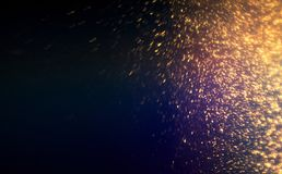 Golden glittering magic lights abstract background with gold par. Ticles. Christmas, festive, party design Stock Photo