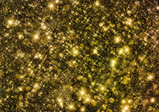 Golden glittering space shine. Golden glittering space shining textured background Royalty Free Stock Photo