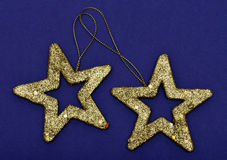 Golden glittering star Christmas ornament Stock Images