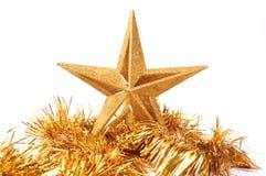 Golden glittering star shaped Christmas ornament i Stock Images