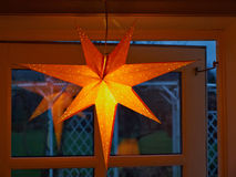Golden glittering star shaped Christmas paper ornament Royalty Free Stock Photos