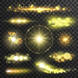 Golden glittering stars with lens flare effect. Golden glittering stars. Sparkling sun light flashes with lens flare effect on transparent background. Vector Royalty Free Stock Photo