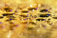 Golden drops background Stock Photography