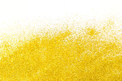 Golden glitters background. Holiday background. Gold dust texture with glitter Royalty Free Stock Images