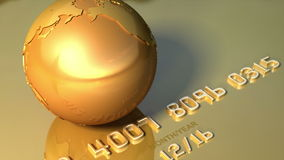 Golden globe rotates around his axis on golden credit card. Business, travel 3d animation for video background. Gold planet Earth on golden credit card stock video