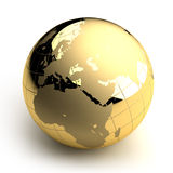 Golden Globe on white background. Metal globe of the Earth with a golden hue as it were photographed in the studio. 3D-graphics stock illustration