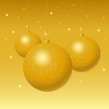 Golden globes. Golden christmas balls on stars background Royalty Free Stock Photo