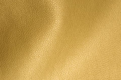 Golden Glossy Artificial Leather Background Texture Close-Up Stock Photography