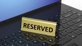 Golden glossy reservation sign on laptop keyboard Stock Photography