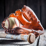 Golden glove and old baseball ball Stock Image