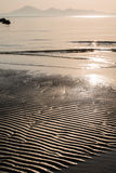 Golden glow beach ripples in sand Royalty Free Stock Photos