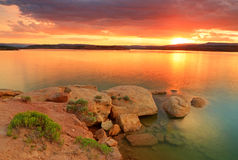 Golden glow at a desert lake. Golden sun glow in Starvation Reservoir, Utah, USA Royalty Free Stock Photography