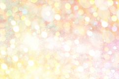 Golden Glow glitter background. Elegant abstract background with bokeh Royalty Free Stock Photography