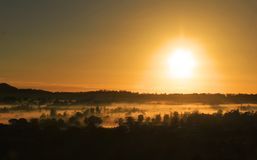 Golden Glow Of Morning Over Mist In Winter Royalty Free Stock Photography