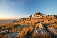 Golden Glow over the Cheesewring, Bodmin Moor, Cornwall royalty free stock photo