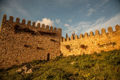 Castle walls of old Spain. The golden glow  of the setting sun on the old, ancient walls of Trujillo Spain Royalty Free Stock Photo