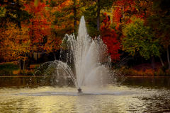 Golden Glow of the Sun on a Fountain Royalty Free Stock Photos