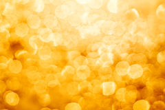 Golden glowing bokeh Royalty Free Stock Photography