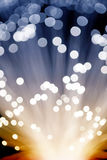 Golden glowing fibre optic light Stock Images
