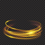 Golden glowing fire rings with glitters. Glowing fire rings with glitter in gold colors on transparent background. Light effects. For used on dark backgrounds Stock Image