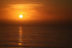 Golden glowing sunset on the Pacific Ocean in California Royalty Free Stock Photo