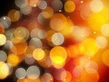 Golden glowing warm background with glittering highlights and soft yellow and silver blurred round lights royalty free stock images