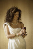 Golden goddess holding burning candle Stock Photography